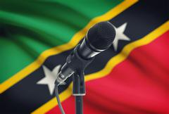 Microphone with national flag on background series - Saint Kitts and Nevis Stock Photos