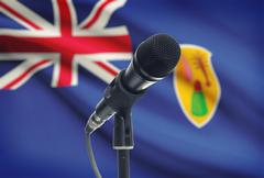 Microphone with national flag on background series - Turks and Caicos Islands - stock photo