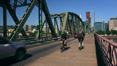 Cyclists  and Cars Cross the Hawthorne Bridge Into Portland, Oregon Stock Footage