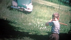 1953: City kids visiting the farm and playing baseball with whatever they had. Stock Footage