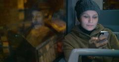 Young woman typing sms during bus ride Stock Footage