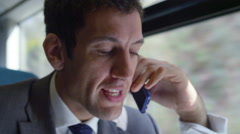 4k, angry businessman on his mobile phone on commuter train Stock Footage