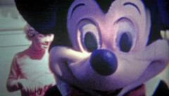 1956: Mickey Mouse entertaining kids in costume as the park grew. Stock Footage