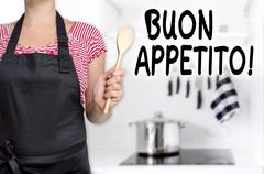 Buon appetito cook holding wooden spoon background Stock Photos