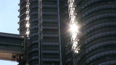 Sun glinting of one of the Petronas Towers Stock Footage