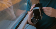 Woman using retro video camera to shoot the way Stock Footage