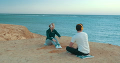 Young people enjoying sea view and music Stock Footage