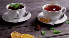 Cups of tea with different spice and mint. Black tea. Stock Footage