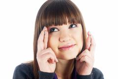 Attractive girl with crossed fingers Stock Photos