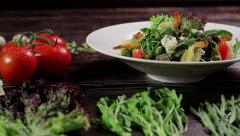 Salad with shrimps and ingredients on a wooden background. Stock Footage