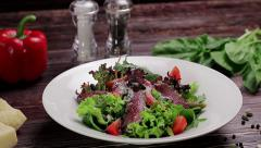 Salad with veal and vegetables sprinkled with parmesan cheese. Stock Footage