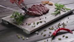 Chef lays out nice steak on a wooden board. Stock Footage