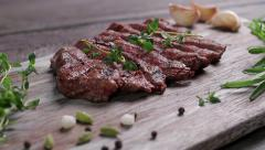 Beef steak on a wooden board with spices. Stock Footage