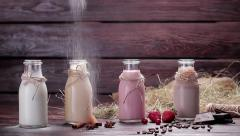 Various natural milkshakes sprinkled with powdered sugar. Beautiful interer. - stock footage
