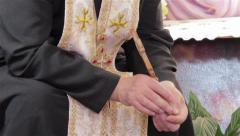 Priest holding cross Stock Footage