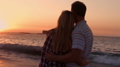 Cute couple hugging during the sunset on the beach Stock Footage