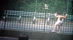 1953: Kids playing at a New York City public swimming pool. Stock Footage