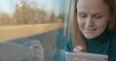 This is how she spending time in train - stock footage