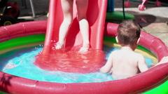 Children Splashing and Playing in Swimming Pool - stock footage