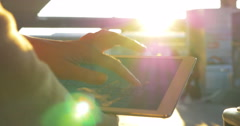 Woman chatting on touch pad in bright sunlight Stock Footage