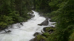 Mountain stream in the forest. Austria, Obertraun Stock Footage