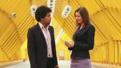 Man and woman in formal clothing talking and smiling Stock Footage