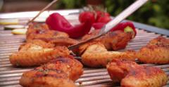 Spicy chicken wings being grilled on a barbecue Stock Footage