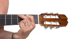 Old hand and guitar isolated - stock photo