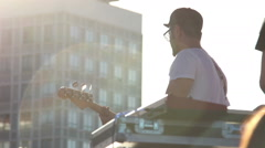 Guitarist playing guitar on the street, the glare from the sun, a concert Stock Footage