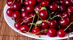 Plate With Mouthwatering Cherries, Stop Motion, Tilt Stock Footage