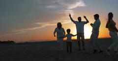 Happy big family enjoying evening on the beach Stock Footage