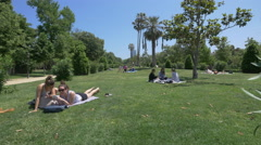 Young people and families relaxing in Ciutadella Park, Barcelona Stock Footage