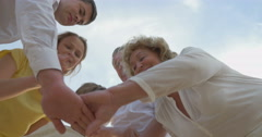 Family Members Putting Hands Together - stock footage