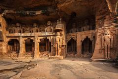 Rockcut Statues of Jain thirthankaras in rock niches near Gwalior fort. Gwali Stock Photos