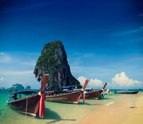 Holiday vacation concept background - Long tail boat on tropical beach with l Kuvituskuvat