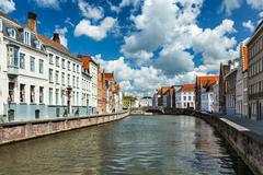 Canal and old houses in Bruges (Brugge), Belgium - stock photo