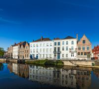 Canal and medieval houses. Bruges (Brugge), Belgium - stock photo