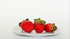 timelapse rotting of three strawberries then ripe again - stock footage