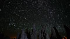 Stock Video Footage of Astrophotography Time Lapse of Star Trails over Tufas in Mono Lake -Tilt Up-