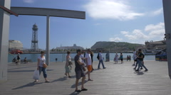 Adults and children relaxing on the seafront in Barcelona Stock Footage