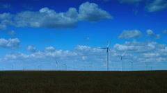 Wind Turbines With Fluctuating Sun Zoom Out, Time Lapse. Stock Footage