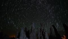 Astrophotography Time Lapse of Star Trails over Tufas in Mono Lake -Zoom Out- - stock footage