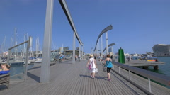 Two women walking on Rambla de Mar, Barcelona - stock footage