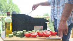 Closeup of man cooking, grilling meat on barbecue - stock footage