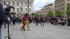 Young people couple dance fun Lindy hop dancing in the square. 4K Stock Footage