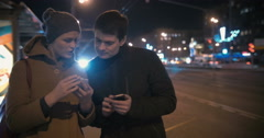Man taking girls phone number in the street Stock Footage