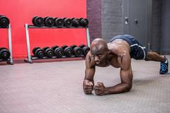 Young bodybuilder doing excercises - stock photo