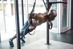 Young bodybuilder doing excercises Stock Photos
