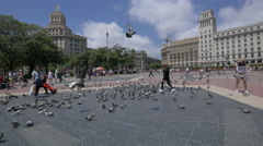 Chasing pigeons in Plaza de Catalunya, Barcelona Stock Footage