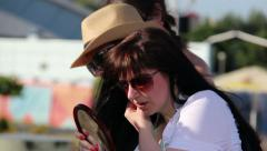 trying on earrings at a street fair, look in the mirror - stock footage